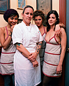 USA, California, Los Angeles, portrait of Chef Carolynne Spence standing with waitress and smiling at Bar Marmont.
