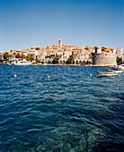 CROATIA, Korcula, Dalmatian Coast, waterfront with buildings in the background in Korcula.