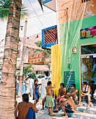 MEXICO, Sayulita, group of friends in conversation outside building
