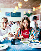 MEXICO, Mexico City, two young women eating at Contramar Restaurant