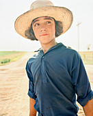 USA, Minessota, portrait of a young Amish boy with hat.
