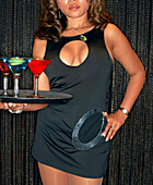 USA, Nevada, Las Vegas, waitress with martini glasses on tray at the Mandalay Bay Hotel and Casino, ONE