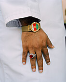 OMAN, man wearing wristwatch and finger ring, flag designed on watch dial