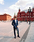 RUSSIA, Moscow, Kremlin, young man posing with people in the background