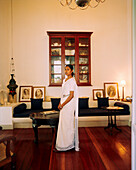 SRI LANKA, Asia, Galle, portrait of a woman in sari standing in library of the Amangalla Hotel in Galle.