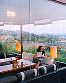 TURKEY, Istanbul, mid adult female looking away while sitting in Ulus 29 Restaurant