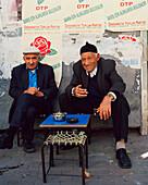 TURKEY, Istanbul, portrait of smiling senior men at tea stall