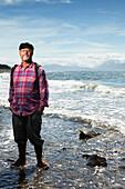 ALASKA, Homer, longtime local and fisherman Bumpo Bremicker at Bishop Beach, Kachemak Bay
