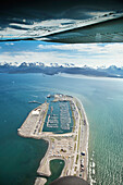 ALASKA, Homer, an aerial view of the Homer Spit and marina, Land's End, Kachemak Bay with the Kenai mountains in the distance
