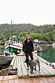 ALASKA, Homer, Marian Beck, the owner of the Saltry restaurant with her dog Pico, Halibut Cove
