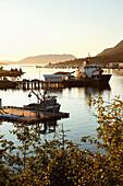 ALASKA, Sitka, fishing boats docked in Sitka Harbor at sundown