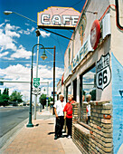 USA, Arizona, Holbrook, senior couple standing at entrance of the Route 66 Cafe