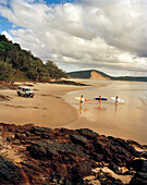 AUSTRALIA, Queensland, Noosa Heads, surfers explore 40 mile beach to find some waves