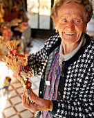 AUSTRIA, Weiden Am See, Magdalena Horvath at her farm stand sells wheat and dried flower arrangements, Burgenland