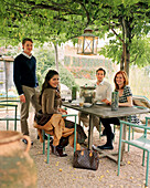 AUSTRIA, Schutzen Am Gerbige, friends enjoy an afternoon coffee at the Taubenkobel Hotel and Restaurant, Burgenland