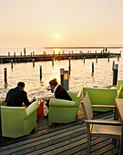 AUSTRIA, Neusiedl Am See, afternoon coffee at the Mole West Café and Bar Restaurant, Lake Neusiedler See, Burgenland