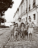BRAZIL, Belem, South America, portrait of happy shirtless boys, one with soccer ball