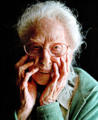 USA, California, portrait of a 103 year old woman on a black background
