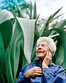 USA, California, happy 100 year old woman at the Bancroft Gardens