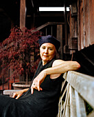 USA, California, Berkeley, chef and author Alice Waters in front of her aclaimed restaurant Chez Panisse