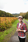 USA, California, Sonoma, Kit Paquin smiles in the vineyard at Ravenswood winery and vineyard