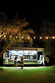 USA, California, Malibu, people line up for food at a food truck in the Malibu Hills at Saddleback Ranch