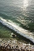 USA, California, Malibu, birds eye view of a wave breaking at Big Dume