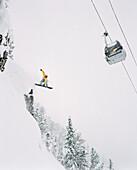 CANADA, snowboarder getting air, Kicking Horse Alpine Resort