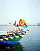 ERITREA, Assab, Yemenese fishermen on the front of their boat in the Port of Assab , Red Sea