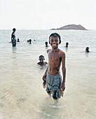 ERITREA, Beraasole, kids swim in the Red Sea in the fishing village of Beraasole