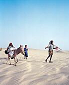 ERITREA, Tio, a Bedouin family walks through the desert on their way to Tio