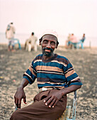 ERITREA, Massawa, Abdullah waits for his coffee at an outdoor café by the Port of Massawa