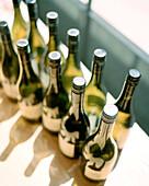 FRANCE, Chablis, Burgundy, wine bottles in a window, elevated view, Laroche Restaurant