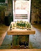 FRANCE, Burgundy, wine bottles in tasting room, Laroche Restaurant, Chablis