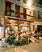 FRANCE, Burgundy, people sitting at outdoor cafe at night, Beaune