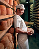 FRANCE, cheese maker Fabrice Michelin at the Fromagerie Michelin, Franche-Comte region, Mont D'or Cheese