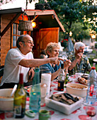 FRANCE, Arbois, family and friends celebrate La Fete de Voisins in the town of Arbois, neighborhood party, Jura Wine Region