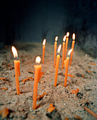 GREECE, Chora, Dodecanese Island, candles lit inside St. John's Cathedral at the top of the island in the village of Chora