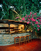 GREECE, Patmos, Grikos, Dodecanese Island, outdoor bar area at the Petra Hotel