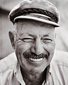 GREECE, Patmos, Diakofti, Dodecanese Island, portrait of Mihais Grillakis, the owner of Diakofti Taverna (B&W)