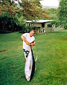 USA, Hawaii, The Big Island, lifting a Yellowfin Tuna, Kealakekua Bay