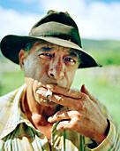 USA, Hawaii, close-up of a hawaiian cowboy smoking, Parker Ranch