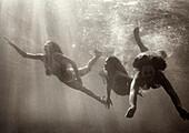USA, Hawaii, women swimming in sea, Kealakekua Bay, The Big Island (B&W)