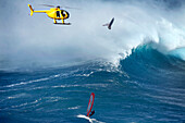 USA, Hawaii, Maui, a man windsurfs and gets big air on a wave at a break called Jaws or Peahi