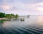 HONDURAS, Roatan, seascape with piers, Halfmoon Bay