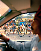 INDIA, West Bengal, close-up of taxi driver and bike taxi's, Bagdogra