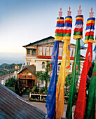 INDIA, West Bengal, colorful flags in front of hotel, Cochrane Palace, Kurseong