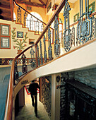 INDIA, West Bengal, hotel interior with curved stairway, Cochrane Palace, Kurseong