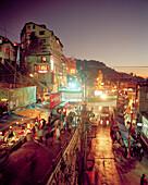 INDIA, West Bengal, street and market scene at night, Darjeeling