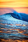 INDONESIA, Mentawai Islands, Kandui Resort, wave in Indian Ocean at sunset
